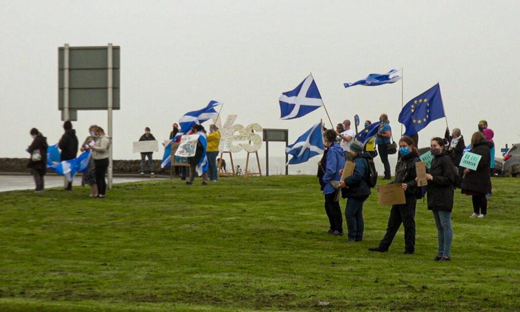 Flag waving protestors at Ayre Mills roundabout in Kirkwall