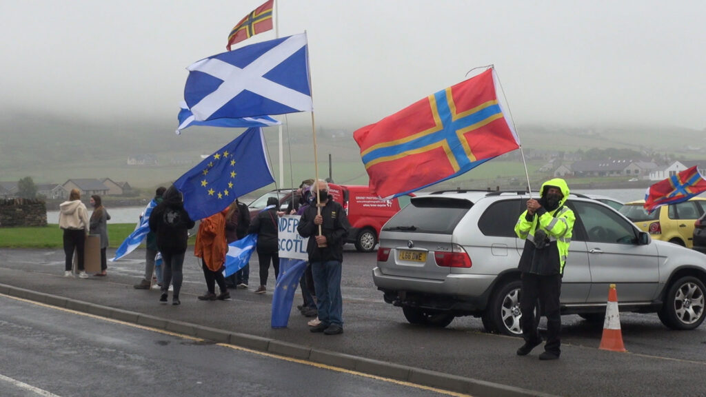 Protestors waiting for the motorcade in Finstown