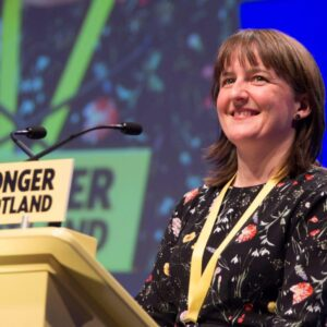 Maree Todd MSP standing at a lectern during a conference